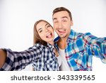 cheerful funny couple in love... | Shutterstock . vector #343339565