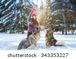 Young Girl Playing With The Dog ...