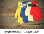 workers gloves and wrench on... | Shutterstock . vector #343359524
