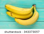 bunch of bananas on wooden... | Shutterstock . vector #343373057