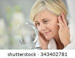 senior woman in bathroom... | Shutterstock . vector #343402781