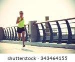 runner athlete running at... | Shutterstock . vector #343464155