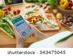 Woman Using Calorie Counter...
