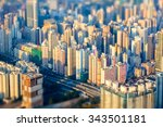 Small photo of Tilt shift blur effect. Abstract futuristic cityscape with modern skyscrapers. Hong Kong aerial view evening panorama
