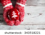 mitten with christmas ball on... | Shutterstock . vector #343518221