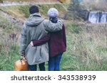 Young Couple Walking In Nature