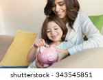 mother and daughter putting... | Shutterstock . vector #343545851