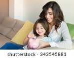 mother and daughter putting... | Shutterstock . vector #343545881