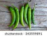 Green Peppers Isolated On Wood...