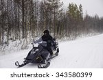 Man Driving A Snowmobile In...