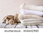 stack of white cozy knitted... | Shutterstock . vector #343642985