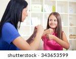 smiling deaf girl learning sign ... | Shutterstock . vector #343653599