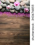 spa stones and orchid on wooden ... | Shutterstock . vector #343676855