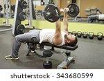 man doing e z curl bar skull...   Shutterstock . vector #343680599