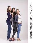 Stock photo portrait of three girls in high heel shoes studio shot white clean background 343717214