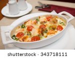 baked fish with tomatoes  | Shutterstock . vector #343718111