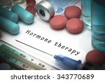 Small photo of Hormone therapy - diagnosis written on a white piece of paper. Syringe and vaccine with drugs.
