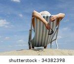 Woman Sunbathing On Deckchair...