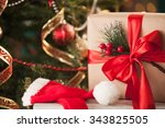 gifts under the christmas tree | Shutterstock . vector #343825505