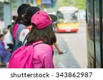 asian girl waiting for bus at... | Shutterstock . vector #343862987