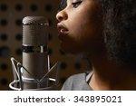 female vocalist in recording... | Shutterstock . vector #343895021
