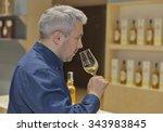 Small photo of KIEV, UKRAINE - NOVEMBER 21, 2015: Unrecognized middle age visitor taste sample of Single Malt Scotch Whisky at 1st Ukrainian Whisky Dram Festival in Parkovy Exhibition Center.