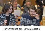 Small photo of KIEV, UKRAINE - NOVEMBER 21, 2015: Unrecognized visitors on company presentation smell and taste The Glenlivet Single Malt Scotch Whiskey at 1st Whisky Dram Festival in Parkovy Exhibition Center.