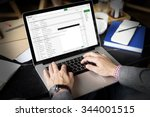 businessman using laptop... | Shutterstock . vector #344001515