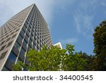 Cityscape of skyscrapers emerging from among the trees - stock photo