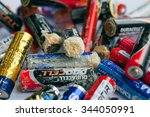 Small photo of KYIV, UKRAINE - NOV 26: Many used batteries with layer of acidification on November 26, 2015. AA battery size was standardized by the American National Standards Institute in 1947