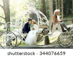 handsome groom kissing blonde... | Shutterstock . vector #344076659