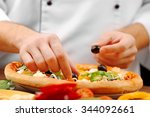 cook making delicious pizza at... | Shutterstock . vector #344092661