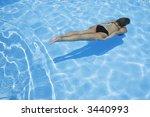 pretty girl in bikini diving... | Shutterstock . vector #3440993