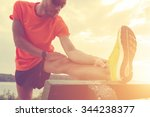 stretching after jogging.   Shutterstock . vector #344238377