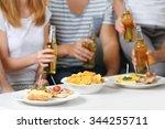 friends hands with bottles of...   Shutterstock . vector #344255711