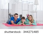 happy parents and their son... | Shutterstock . vector #344271485