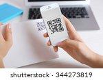 woman scanning voucher code... | Shutterstock . vector #344273819