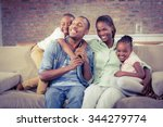 happy family relaxing on the... | Shutterstock . vector #344279774