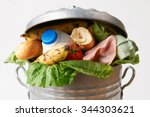 fresh food in garbage can to... | Shutterstock . vector #344303621