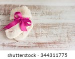 knitted baby socks with rose... | Shutterstock . vector #344311775