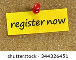 Small photo of register now word on yellow notepaper with cork background.