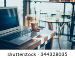 computer laptop and coffee in... | Shutterstock . vector #344328035
