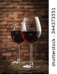 wine glasses on a wooden table... | Shutterstock . vector #344373551
