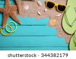 summer items on wooden... | Shutterstock . vector #344382179