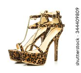 Small photo of Stiletto high heels shoes in animal print design, with high heels shoe in brown suede and with platform sole