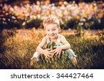 little cute boy sitting... | Shutterstock . vector #344427464