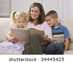 a happy looking mother reading... | Shutterstock . vector #34445425
