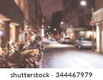 Blurred Image Of A Lane Parked...