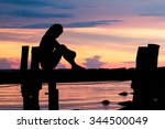 lonely woman sitting on a... | Shutterstock . vector #344500049