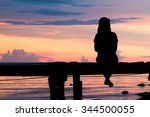 lonely woman sitting on a... | Shutterstock . vector #344500055
